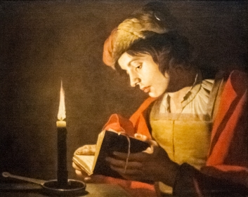 Stom_-_A_Young_Man_Reading_at_Candlelight.jpg